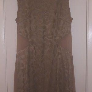 Skin tight tan leather mini dress.